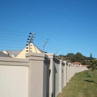 Wall with electric fence
