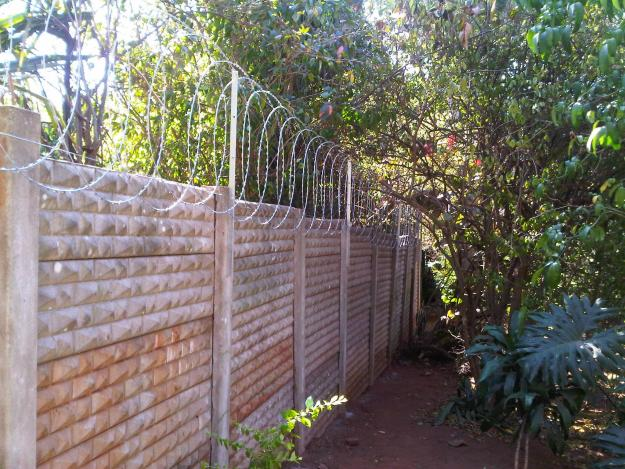 Wall with traditional barbed wire