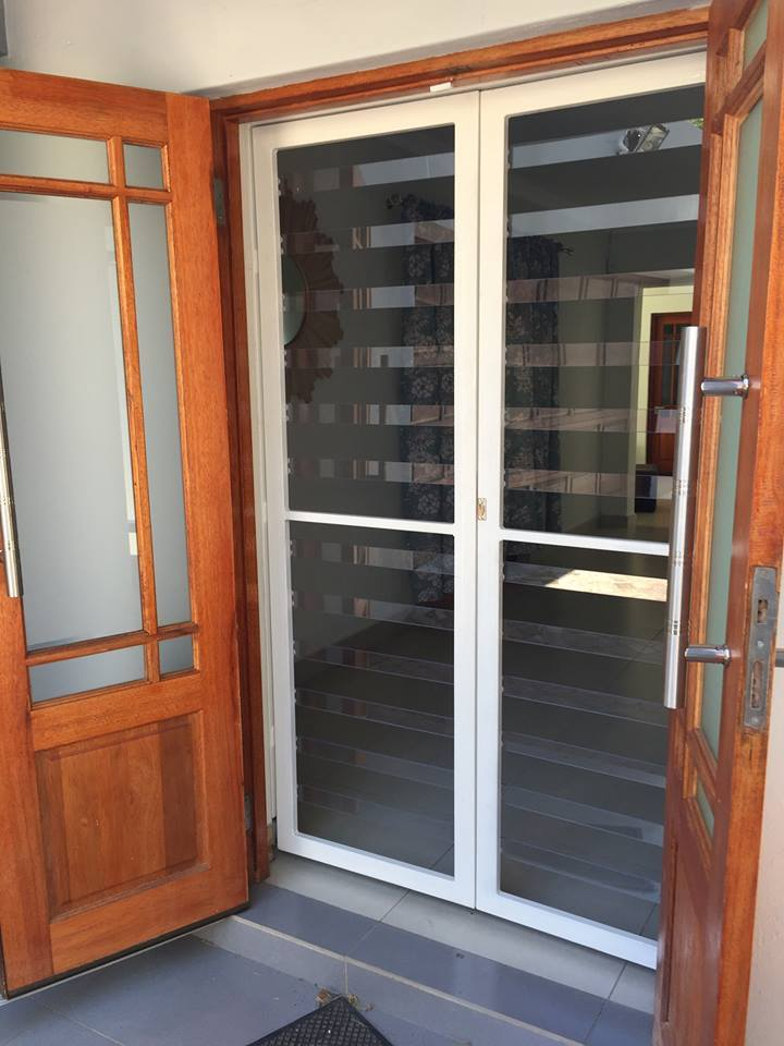 Clear security gate with wooden doors