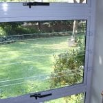 Clear burglar bar with garden in background